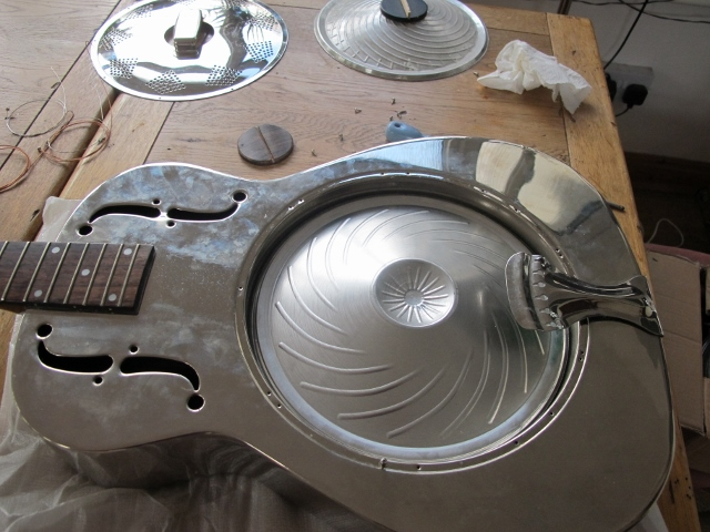 Resonator guitar repairs are a speciality here at Sollophonic Guitars. Here is a nice metal bodied resophonic guitar having a cone upgrade and a replacement bone nut fitted. Give your resonator a new lease of life and a dramatically better tone with a Continental cone fitted for you at Sollophonic Guitars.
