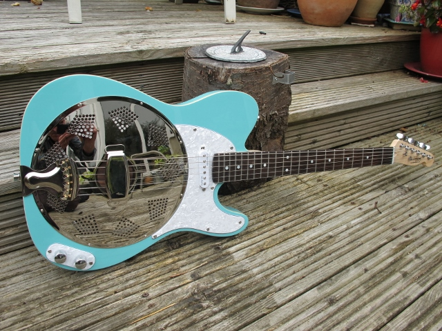 "Lovely surf blue Sollophonic, with an Entwistle pickup, white pearl scratchplate and control plate, Single bound body, rosewood neck, this pre-ordered guitar is a real sweet one. New owners says ""Its fantastic, many thanks. We are very grateful to you for keeping us informed throughout the process-your customer service is exceptionally good."""